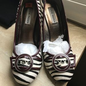 Brand new. Never worn only tried on. Wedge shoes.